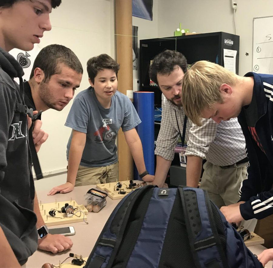 Mr. Shippen teaching members of the Electrical Engineering section.
