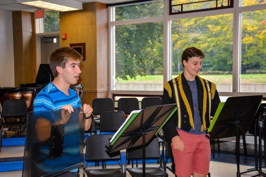 Actors practice their songs for the performance. On left: Senior-Will Glovsky, on right: Junior-Chris Tsouvalas.