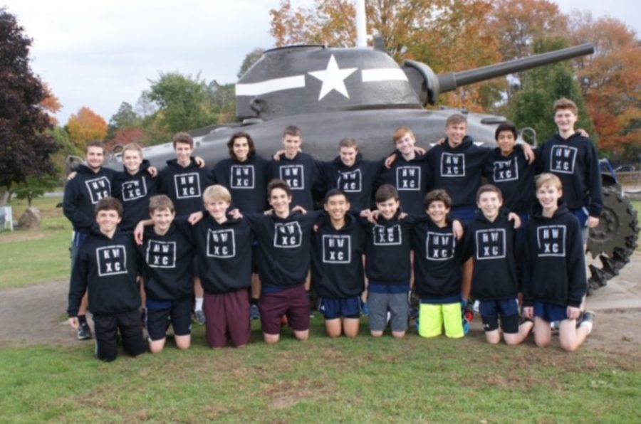 The cross country boys varsity and junior varsity team pose for a team photo at Patton Park.