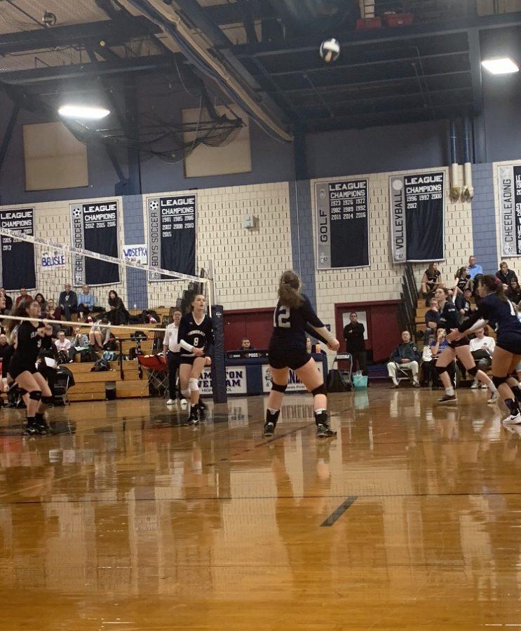 The girls bump the ball toward their teammates.