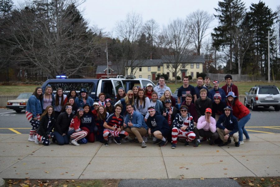 Senior class in front of police cruiser