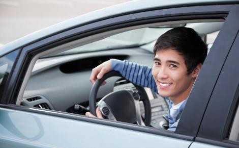 A teen learning how to drive
