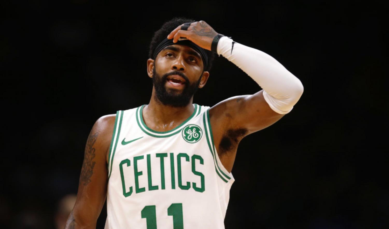 Boston Celtics guard Kyrie Irving during the first quarter of a preseason basketball game versus Kemba Walker's Charlotte Hornets in Boston, Sunday, Sept. 30, 2018. (AP Photo/Charles Krupa) https://www.wbur.org/radioboston/2018/11/21/celtics-thanksgiving-football