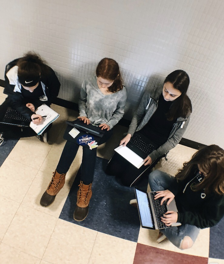 Freshman students from left: Hannah Pasquarello, Ariel Greenberg, Hannah Vidu, and Sarah Mcmahon are forming a study group in the hallway for their language classes.