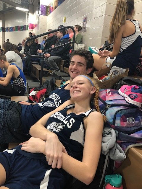 Senior Jake Sturim and Sophomore Gaylan Ryuss hanging out in the stands of Reggie Lewis as the meet begins.