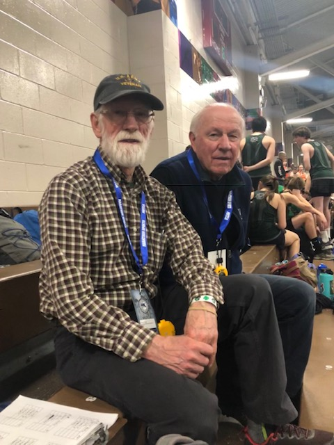 The indoor track coaches get ready to watch the division relays. From left: Coach Dave Sawyer and on the right his older brother Steve Sawyer.