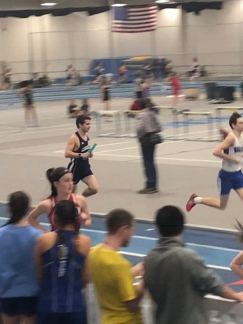 Senior Jake Sturim runs as the boys anchor in the distance medley relay.
