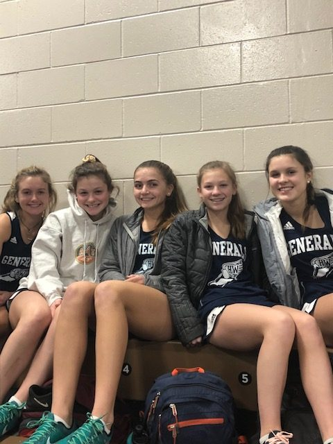 Indoor track girls on the bleachers at Reggie Lewis. From left: Bennett Nostrand, Ali Chapdelaine, Gabi Cooper, Jackie Chapdelaine, and Claire Kurja.