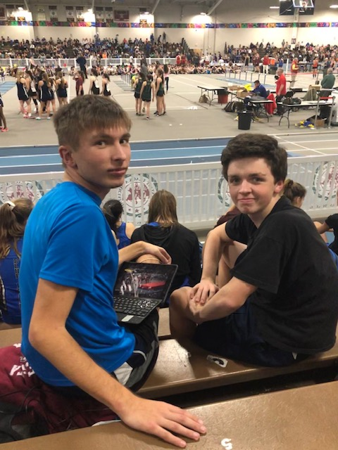 Juniors Scott Janes(on left) and Charlie Butler(on right) are watching the relay races from the bleachers.