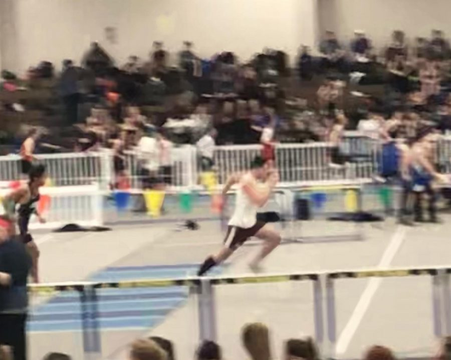 Junior Alex Johnson gains speed during the boys 55 meter shuttle relay.
