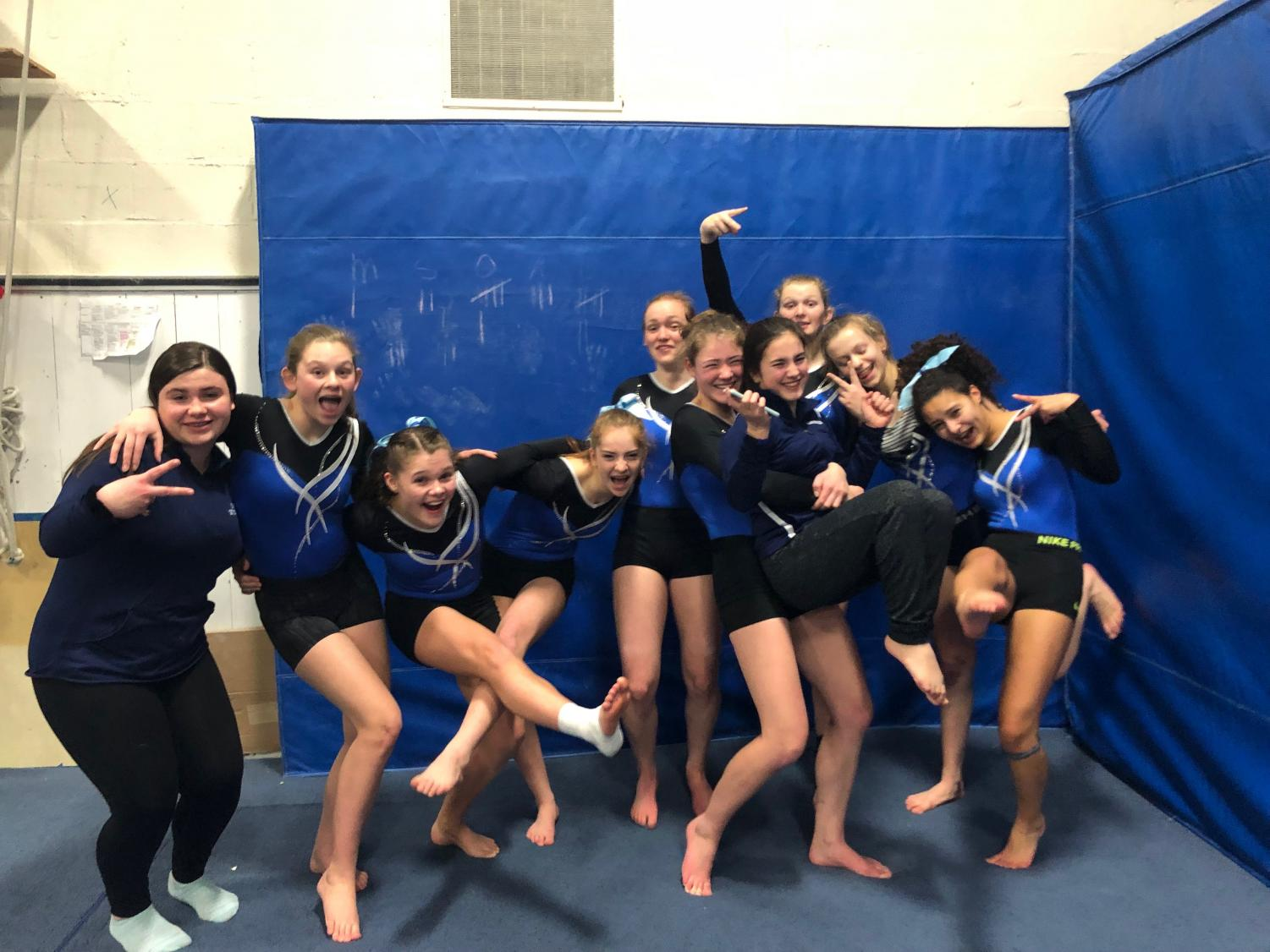 The team all posing together before a home meet. Courtesy of Abby Benack
