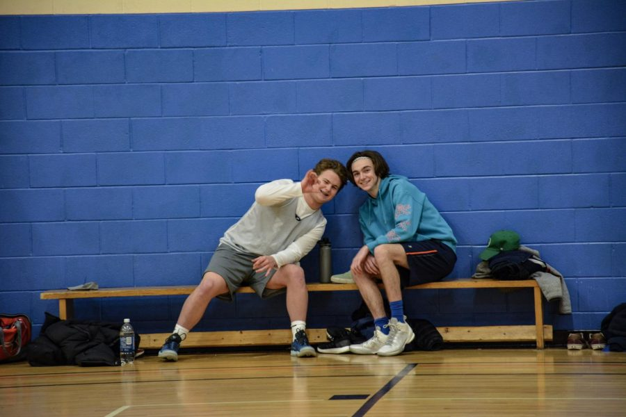 Sam Webber (19) and Josh Muñoz (19) on the bench