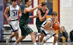 Varsity basketball on the road in second playoff game after win against Triton