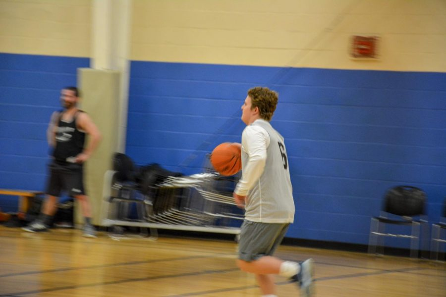Sam Webber (19) flying down the court