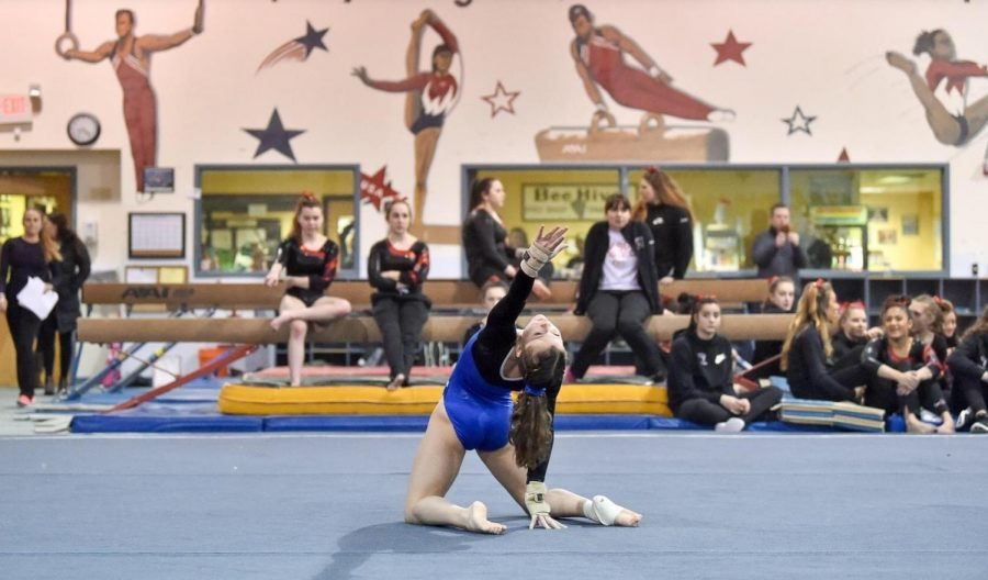 Tess+Richards%2C+a+sophomore+at+Manchester-Essex%2C+competing+in+her+floor+routine.+Courtesy+of+Abby+Benack