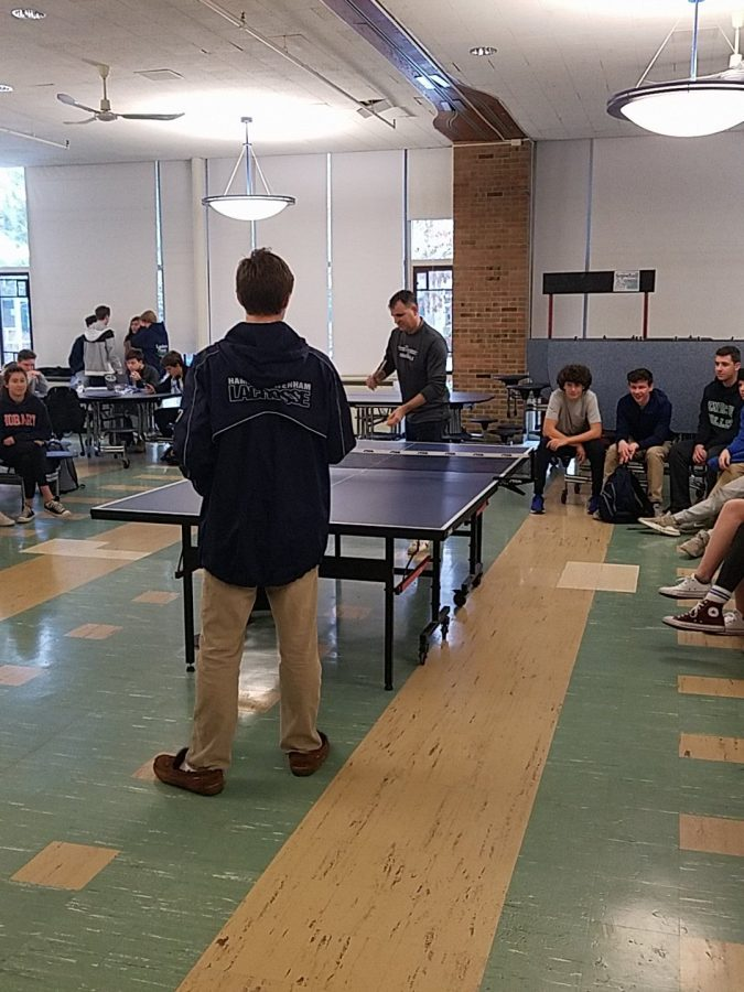 Mr. Maher playing table tennis