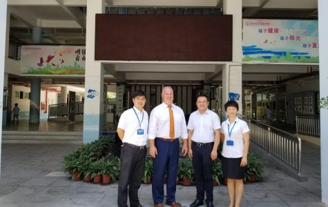 Mr. Tracy with the administrators of Mingde Experimental School, in Shenzhen China.