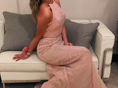 Klaudia Rushi ('20) modeling an Ultimate Prom dress at Hamilton-Wenham's 2019 Junior prom