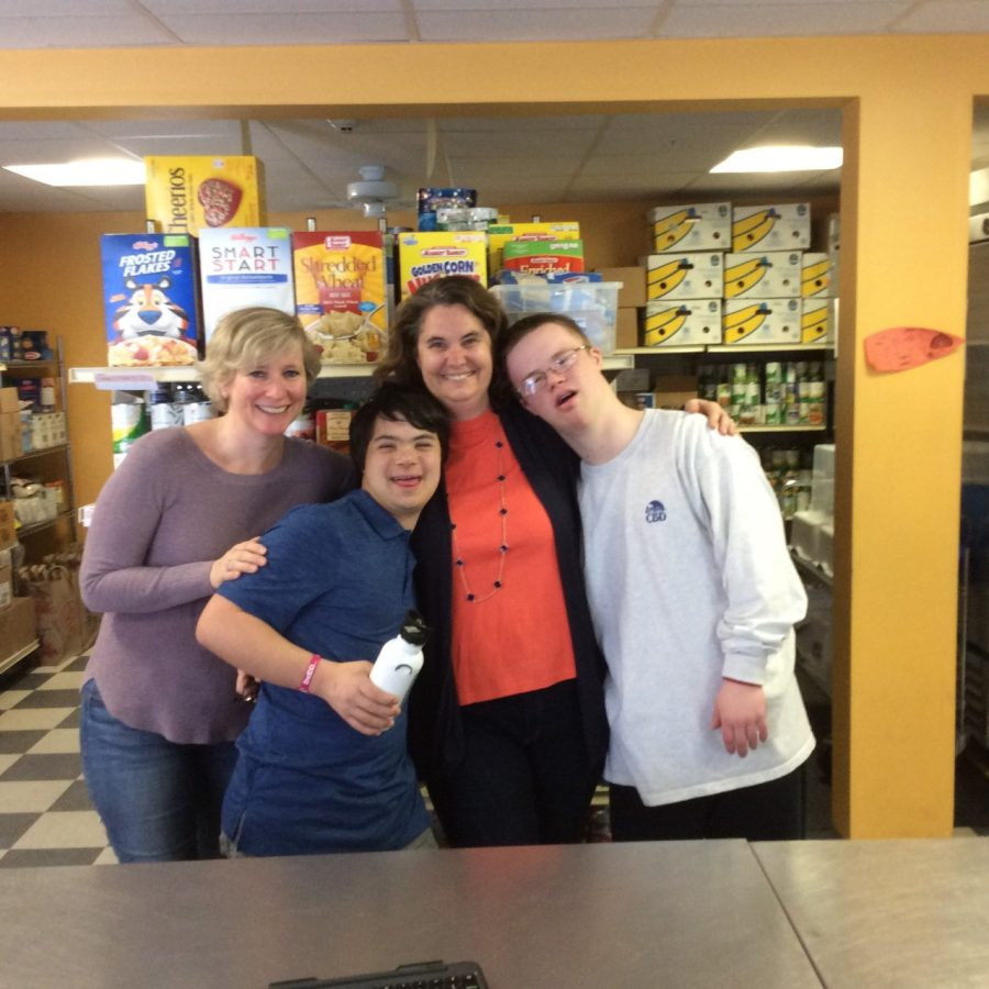 Accord Food Pantry volunteers posing with Max Vanderwilden ('21) and Timothy LaBudde ('21)