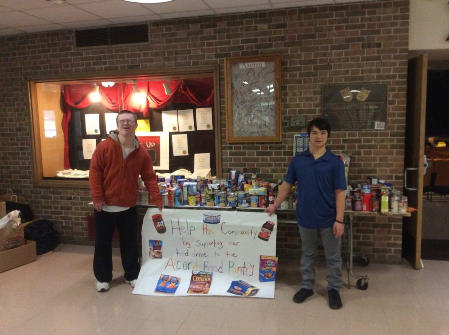 Timothy LaBudde ('21) and Max Vanderwilen ('21) in front of the donations they gathered