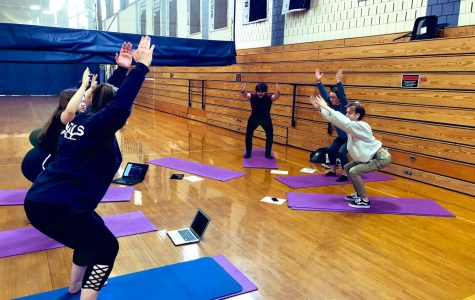 Students practicing for Community Yoga/Pilates sessions