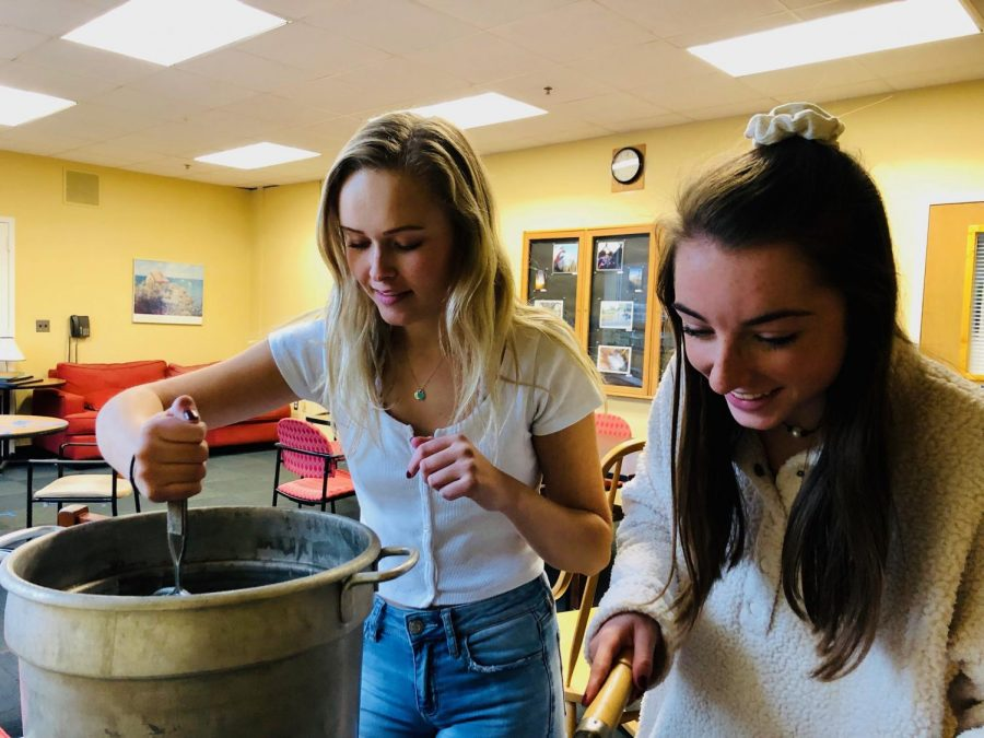 Junior Emily Rooney and Maddy Rostad cooking in the teachers' lounge