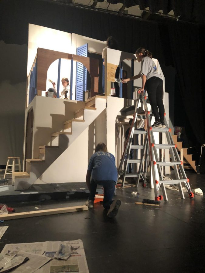 The tech crew works together to create the set.