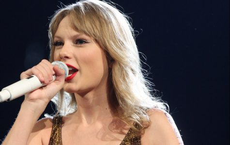 Taylor Swift performs for her fans in Sydney Australia, but refrains from entertaining them at the Grammys.