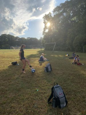Students spread out on the soccer field for a mask break
