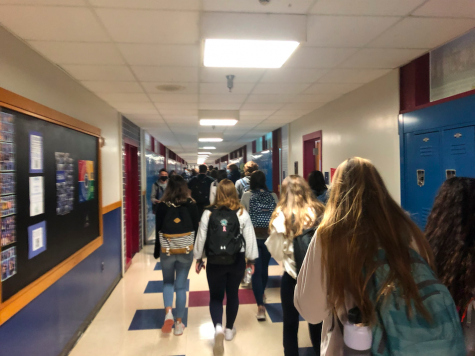 Students in the High School ignore COVID regulations in the tight hallways of the school, something Remote Students seek to avoid.