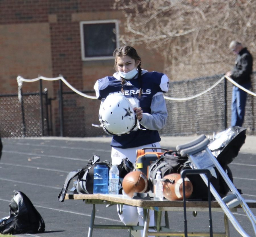 Generals football player Christa Coffey, Class of 2022, prepares to enter the game.  Photograph courtesy of Mr. Leonard Dolan.