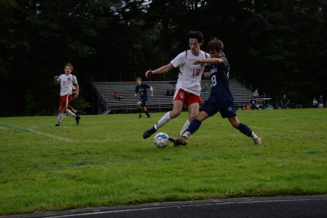 Team captain Rafi Santomenna faces off with Amesbury player for the ball.