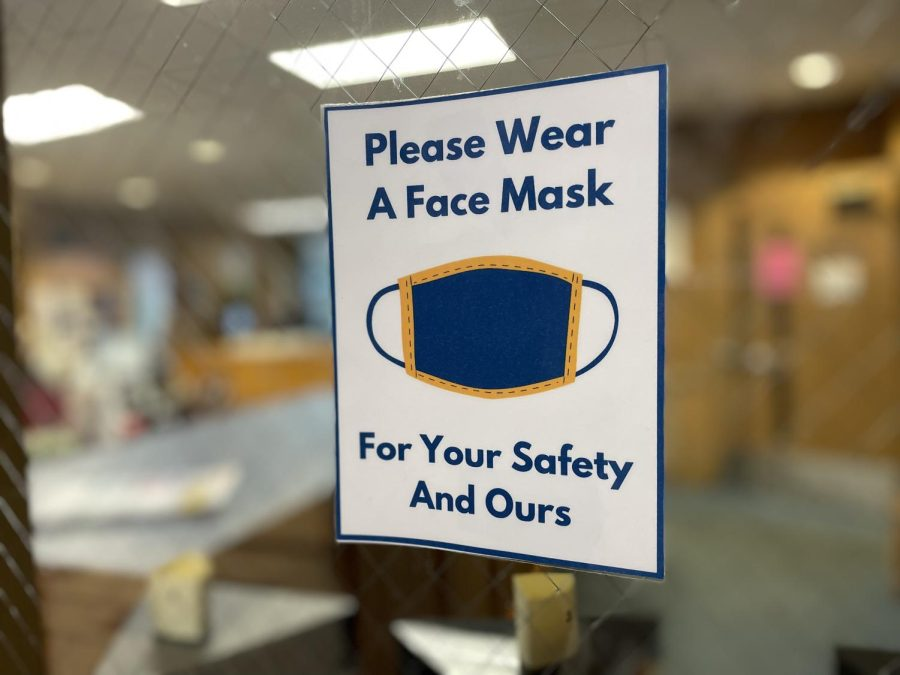 Signs reminding students to mask up remain a common sight in the Regional.