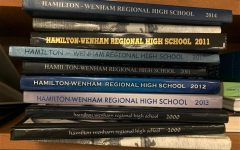 Students work to add the 2021-2022 yearbook to the pile.